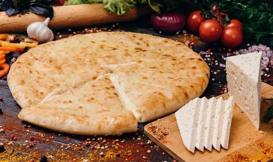 Дрожжевой осетинский сырный пирог в духовке